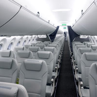 A220 vs B737 MAX - Air Baltic's A220-300 interior with wider seats in a 3-2 configuration