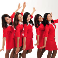 Asian low cost airline pioneer AirAsia's cabin crew sport Virgin red uniforms