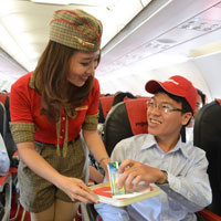 Budget airlines in Asia can be fun, VietJet cabin crew offer PanAm style uniforms and jolly service