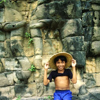 Angkor guide, smiling boy at temple