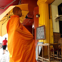 Phnom penh guide, monks seek alms