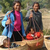 Yangshuo babies hitch a ride in baskets