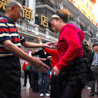 Shanghai fun guide, couples dancing on Nanjing Road