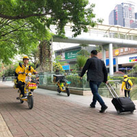 Shenzhen business travellers guide - electric scooters buzz through Futian