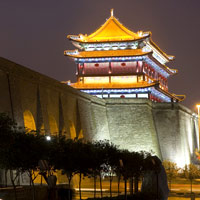 Xian fun guide for families, the city wall and gate lit up at night