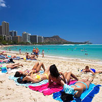Honolulu fun guide, sun-tanning bodies at Waikiki Beach