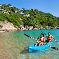 Kids kayaking at Banyan Tree Samui