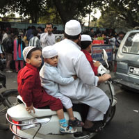 How many people can to cram onto a family scooter in Old Delhi?