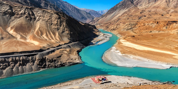 Zanskar winter trek guide - the confluence of the muddy Indus with the turquoise blue waters of the Zanskar River