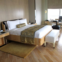 Keraton at the Plaza rooms are spacious, woody and minimalist