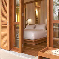 Avani Luang Prabang rooms are understated with light woody tones