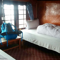 Pokhara area guest houses are clean but simple with chicken curry and rice meals