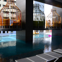 Manila hip hotels, I'M Hotel birdcage loungers at pool