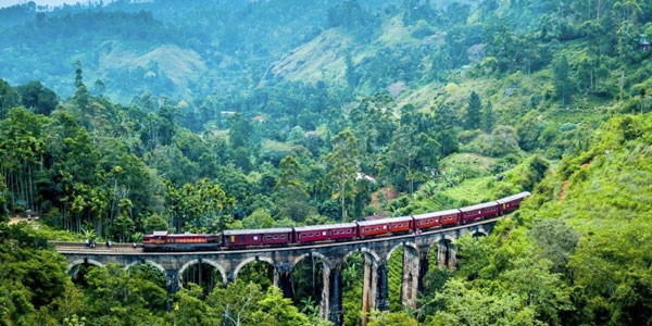 Sri Lanka resorts review from beaches to hilly tea estates - train chugging through the hill country