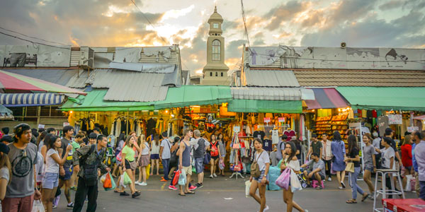 Bangkok fun shopping guide - Chatuchak Weekend Market at dusk packed with tourists