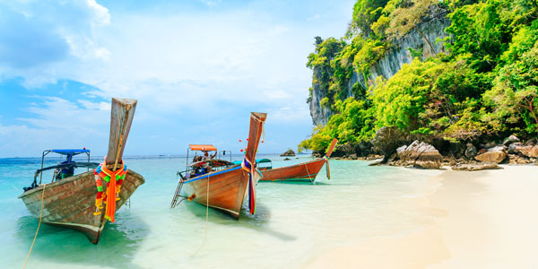 Best travel sites for Asia - Phi Phi beach and longtail boats
