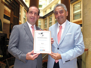 Cavaliere Giovanni Viterale (left), GM of The Fullerton Hotel Singapore with his  No.1 Conference Hotel in Asia Award, with Editor Vijay Verghese