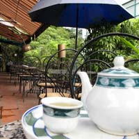 Hanoi fun guide, hideaway Zigzag cafe balcony on Trang Tien Street corner