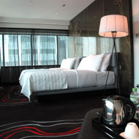 Le Meridien rooms are dark toned and mod