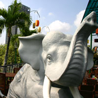 Saigon fun, elephants gambol on the Rex rooftop where big buffets are served