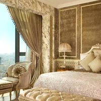 Saigon luxury hotels and suites, The Reverie Suite in gold hues