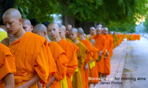 Monks line up for morning aims / photo: James Philips