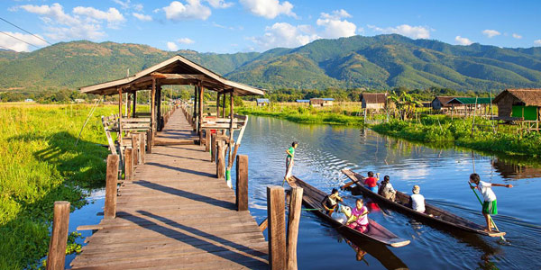 Boats ply on Inle Lake