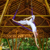 Anti-gravity yoga at Four Seasons Sayan - Dharma Shanti Yoga Bale