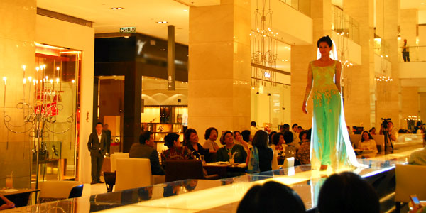 Kuala Lumpur shopping guide and mega-sale tips, model strolls the catwalk at Pavilion Mall
