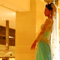 Model on catwalk at Pavilion Mall, a high end Kuala Lumpur shopping escape