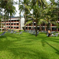 Kata Thani Phuket Beach Resort with its lawns and beachfront is favoured by Europeans